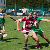 St Joseph's Doora/Barefield David Conroy tackled by Wolfe Tones Barry Loughnane